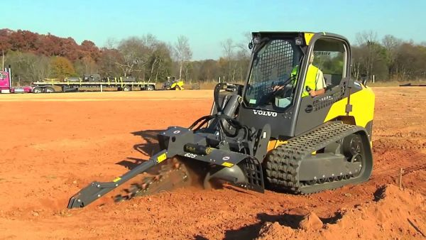 MCT135C Compact Track Loader with tiller attachment