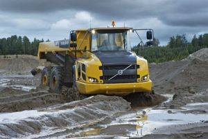 Volvo A30F articulated truck driving through rough terrain