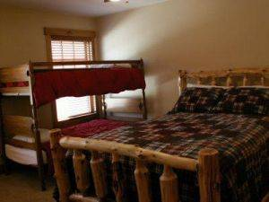 Bear Creek Home Bedroom with queen bed and bunks