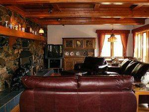 Chalet Senner - Family Room with Stone Fireplace