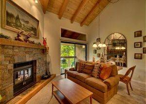 Condo Vacation Rental Living Room with Stone Fireplace