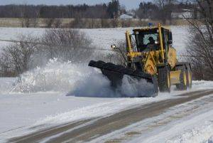 Motor Grader Rental Clearing Snow in Grand Junction, CO