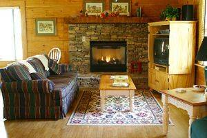 Mountain Magic Family Room with Stone Fireplace, Couch, and TV