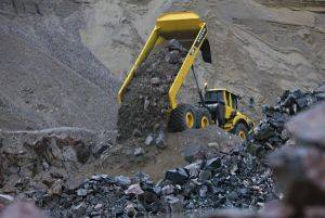 Volvo A30F articulated dump truck rental unloading rock at a mine near Grand Junction, CO