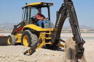 Bl60 Backhoe excavating dirt on jobsite