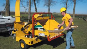 Vermeer bc600xl brush chipper being used on landscaping job