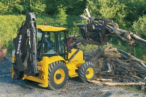 BL60 Backhoe with Claw Attachment loading logs