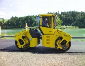 Asphalt Compacter Working On Road