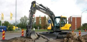 A Durable and Powerful Excavator Working on a Asphalt Surface
