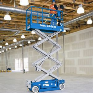 Genie Slab Scissor Lift elevating men inside building