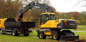 EW210C digger loading dirt into 5yard dump truck
