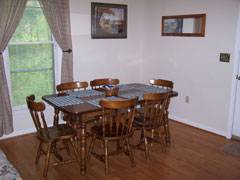 Cabin Foxwood Dining Room with hardwood floors