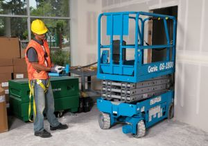 Genie Electric Scissor lift being moved into tight construction space