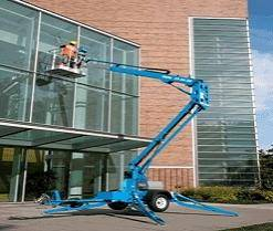 knuckle booms or cherry picker being used to clean windows