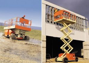 JLG brand scissor lifts moving over rough terrain and working on building