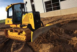 Dozer rental leveling ground around new home construction site