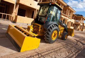 John Deere 210K EP Grading Tractor at work on residential construction site