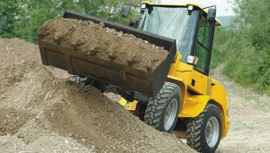 L20F Compact Wheel Loader loading sand