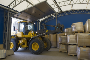 L70G Wheel Loader loading materials in warehouse