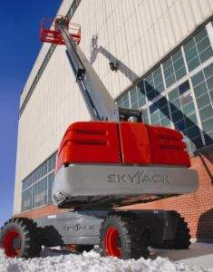 Skyjack straight boom lift being used to clean windows on large building