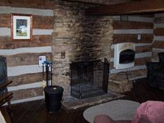 Cabin Logwood brick fireplace