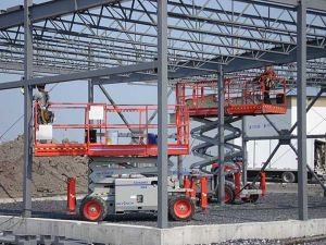 Scissor Lift rentals made by SkyJack elevating workers on construction site