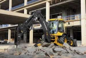 Backhoe Tearing Up Concrete