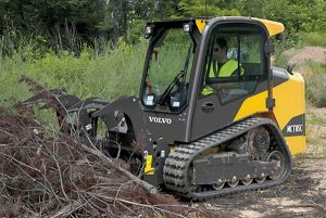 Volvo made Tracked Skid Steer with grappler attachment