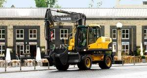 Volvo manufactured wheeled excavator on retail building construction site