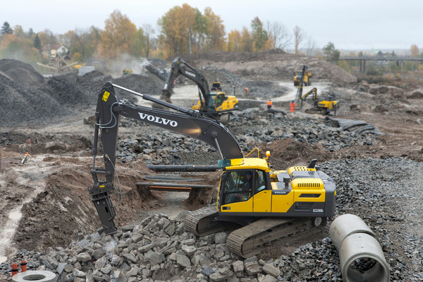 Several Volvo manufactured excavators on aggregate construction site