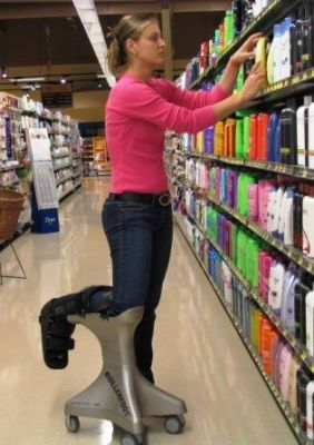 Woman using RollerFoot to get around the store.
