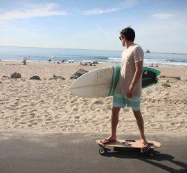 Guy on Beach with Surfboard